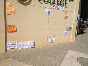 Anti Xenophobia Posters on a school wall in the middle of Rosebank